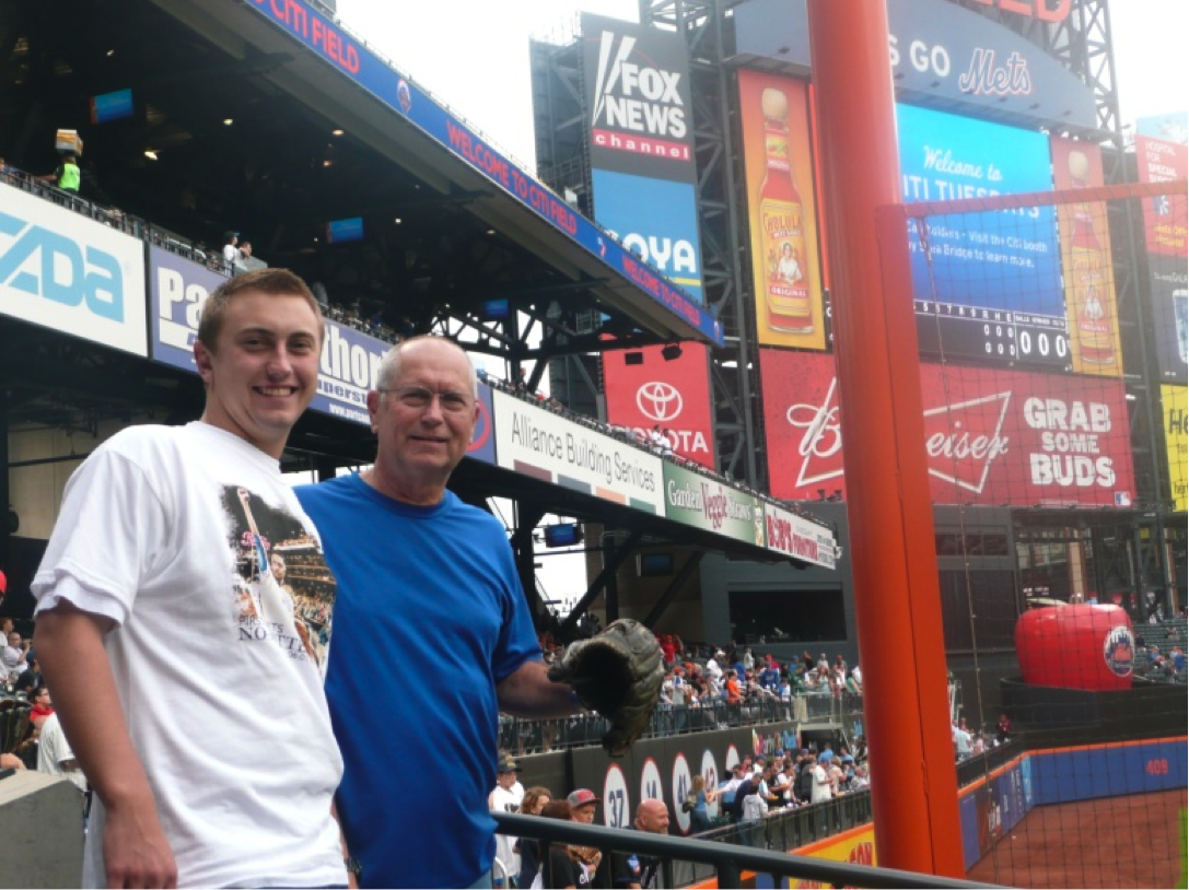 Robert and Charles from California are in Citi Field trying to get a baseball during pre-game BP.